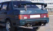 Задний бампер Спорт на ВАЗ 21099 в цвет
