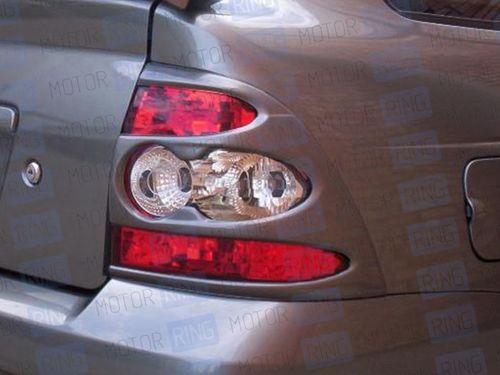Накладки на задние фонари в цвет кузова для Лада Приора_1